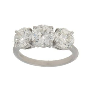 Three-stone diamond engagement ring in platinum