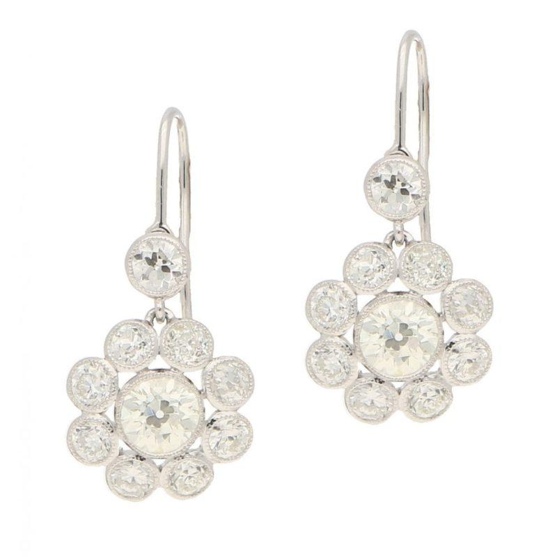 Stunning pair of diamond cluster pendant earrings