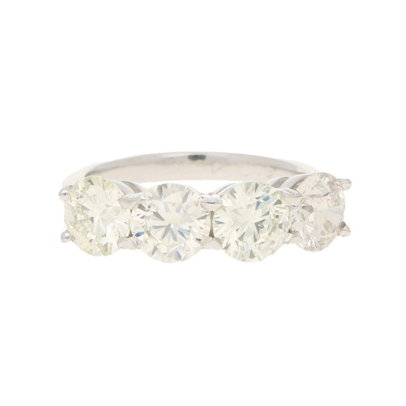 Elegant four stone diamond ring