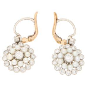 Elegant pearl and diamond pendent earrings