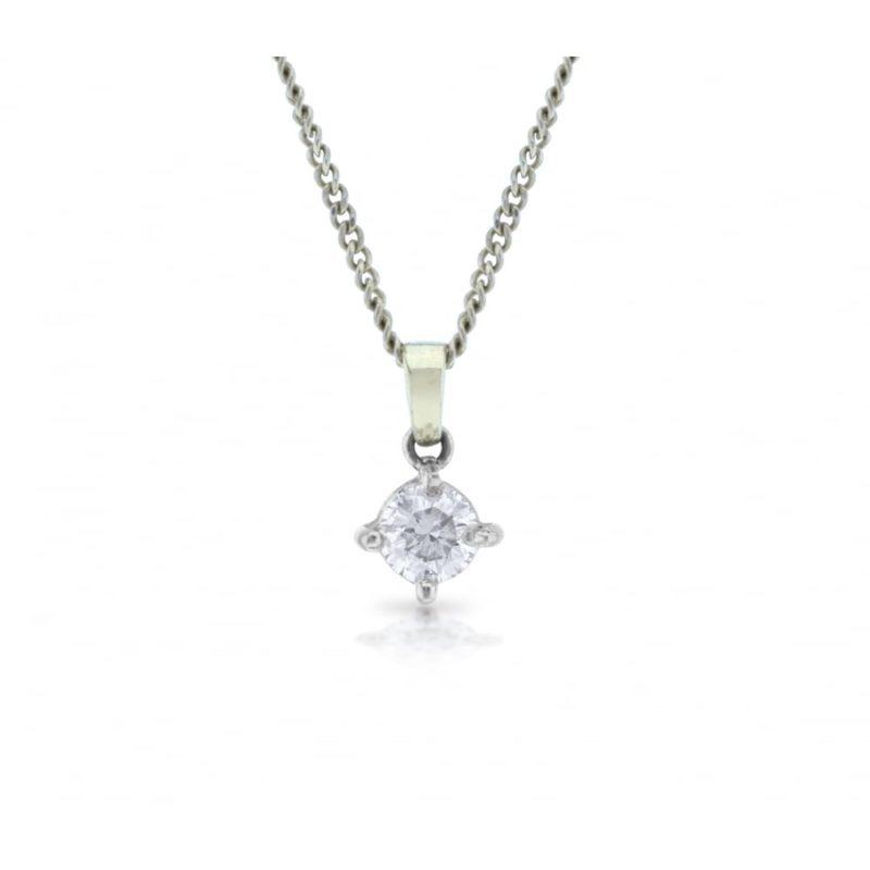 Four claw set round brilliant cut diamond pendant