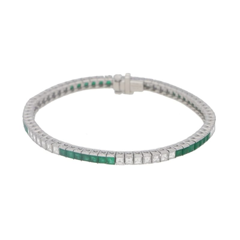Platinum diamond and emerald line bracelet