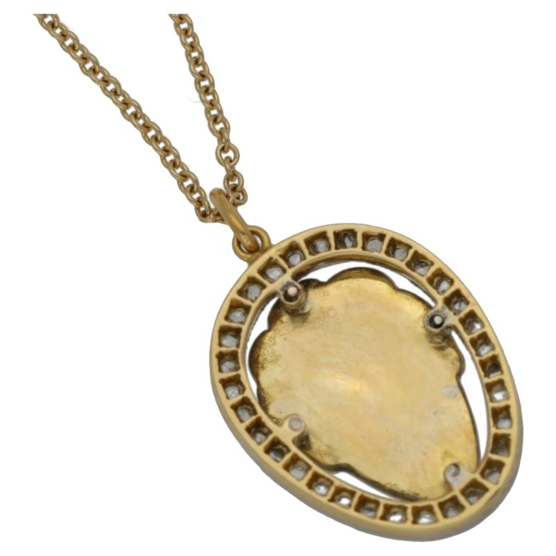 14ct gold face pendant on chain