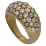 Cartier: Diamond set gold bombé ring