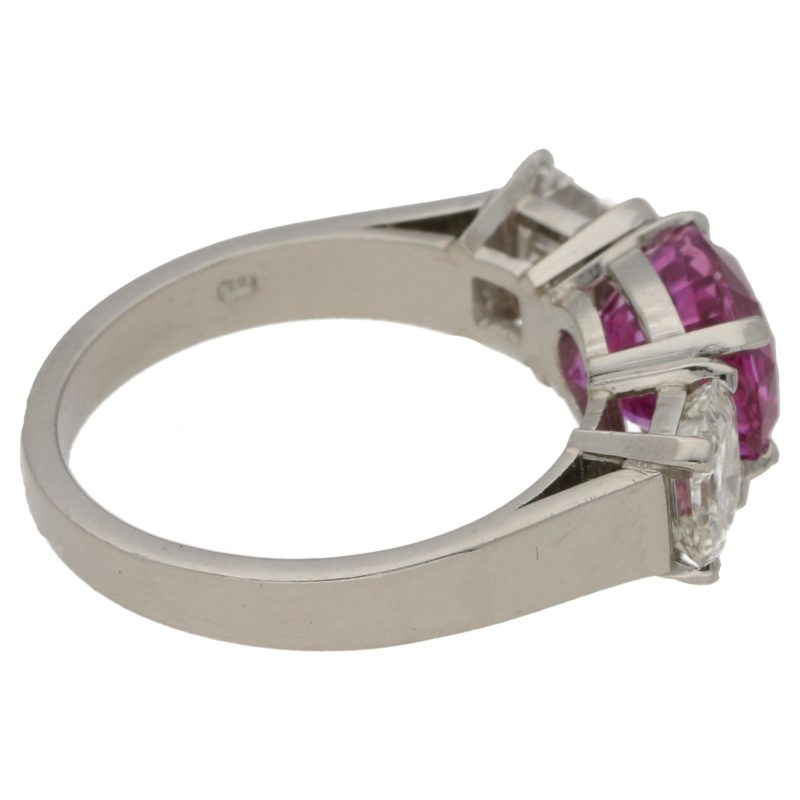 Pink sapphire and diamond three stone ring set in platinum