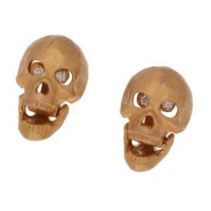Rose gold skull stud earrings with diamond eyes