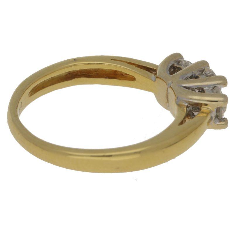 Three stone brilliant cut diamond ring set in 18ct gold