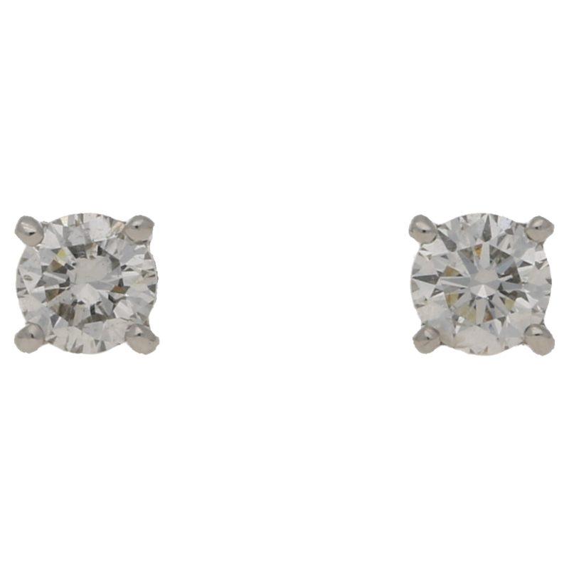 0.40ct total diamond stud earrings in gold