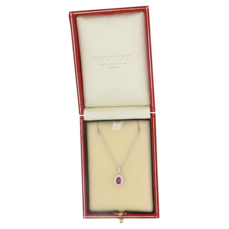 Oval ruby and diamond cluster pendant