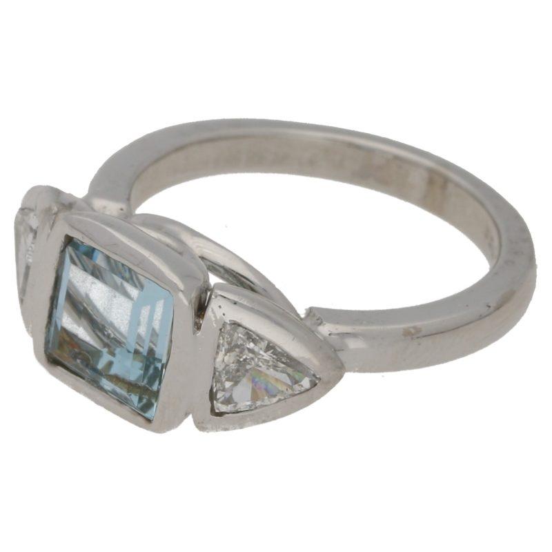 Aquamarine ring with triagonal diamond shoulders