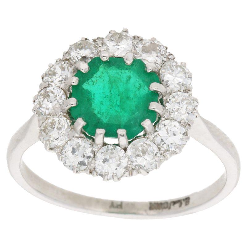 Platinum emerald diamond cluster engagement ring