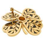 1950's gold pierced openwork onyx flower brooch