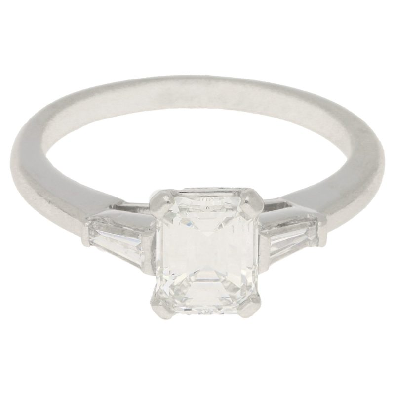 Art Deco style emerald cut diamond engagement ring