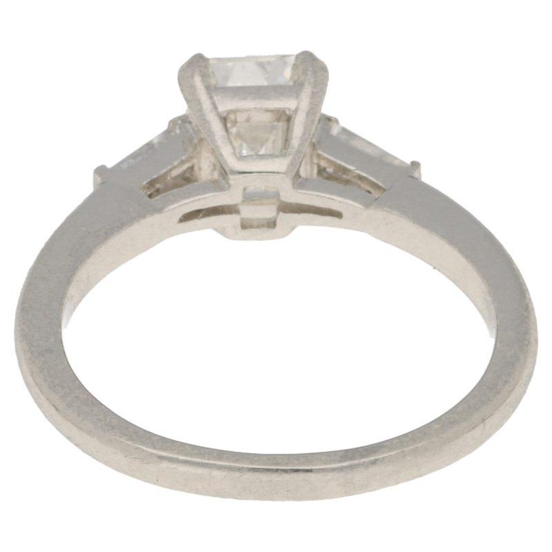 Art Deco style emerald cut diamond engagement ring