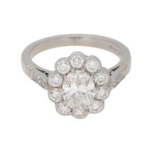 Oval diamond cluster engagement ring