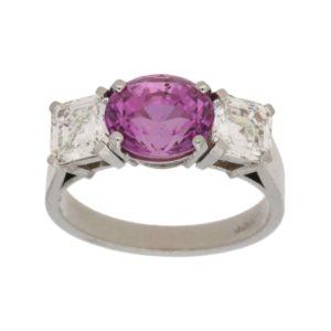 Pink sapphire and diamond three stone ring set in platinum