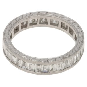 A baguette-cut diamond full eternity ring in platinum