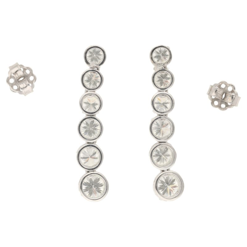 Graduated diamond line drop earrings in white gold