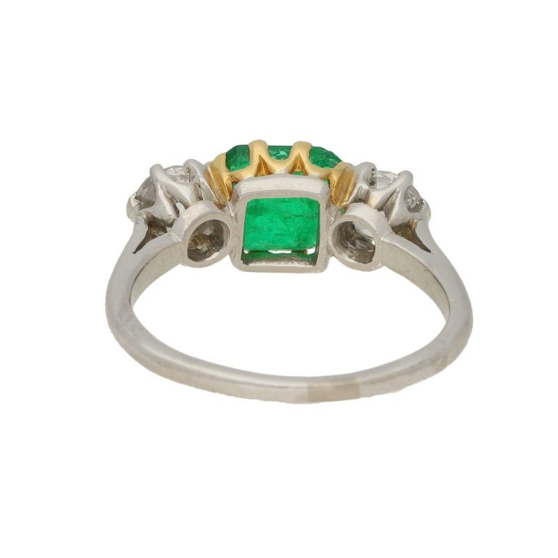 Platinum three stone emerald and diamond ring