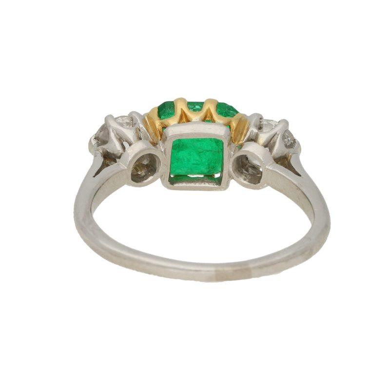 Platinum three stone emerald and diamond ring