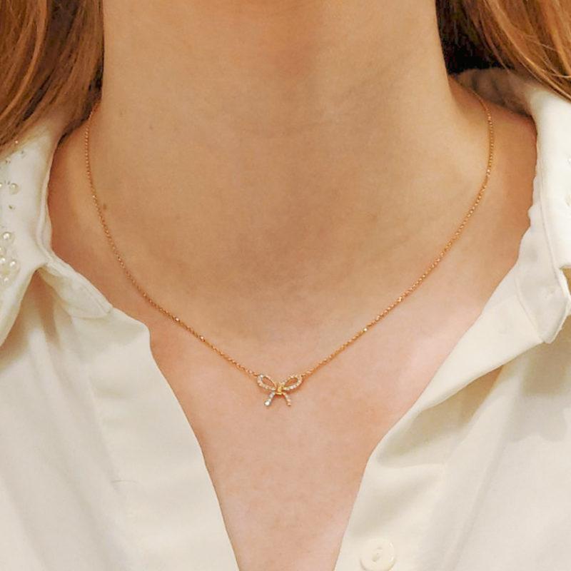 18ct rose gold diamond set bow pendant on a chain