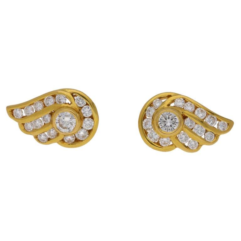 Diamond Stud Earrings in a Wing Design