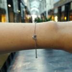 An 18ct white gold diamond set crescent moon chain link bracelet