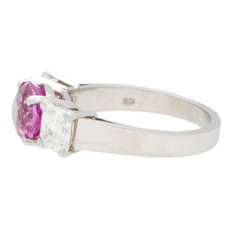 Pink sapphire and diamond three stone ring