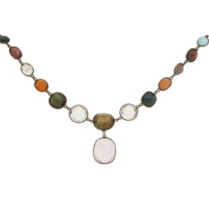 A multi-gem necklace spectacle set in yellow gold
