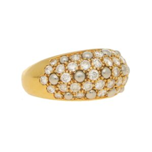 Cartier: Diamond set gold bombé ring