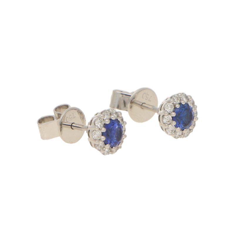 Sapphire and diamond coronet cluster studs earrings.