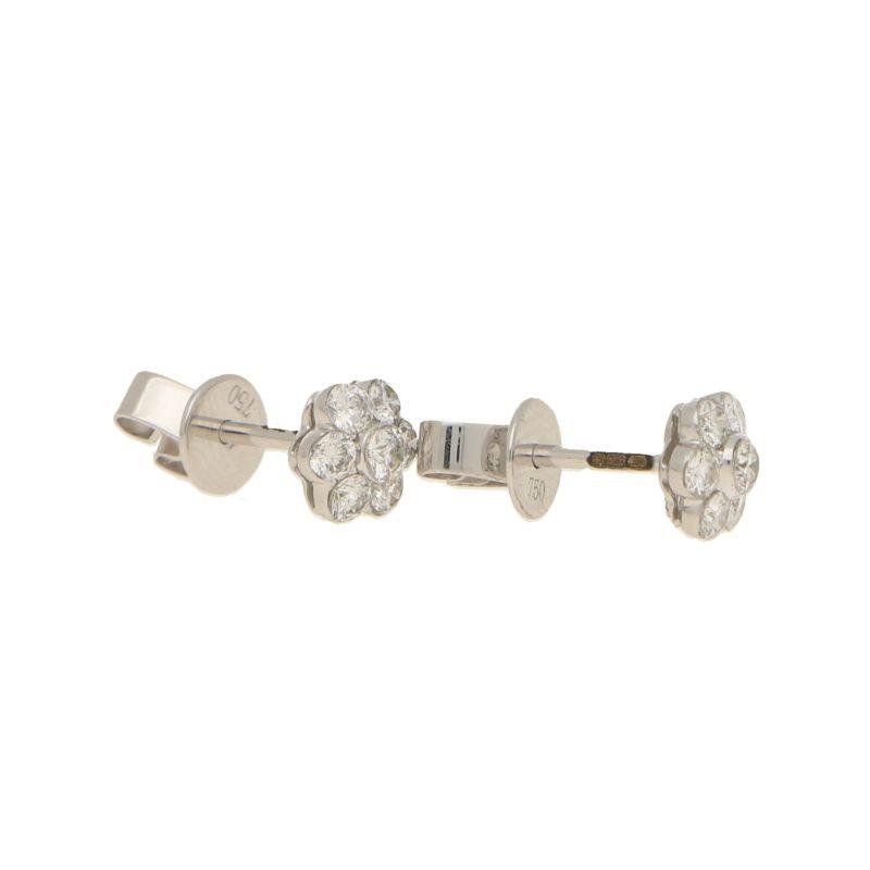 Floral diamond stud earrings in 18k white gold.
