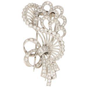 Bow bouquet diamond brooch in platinum.