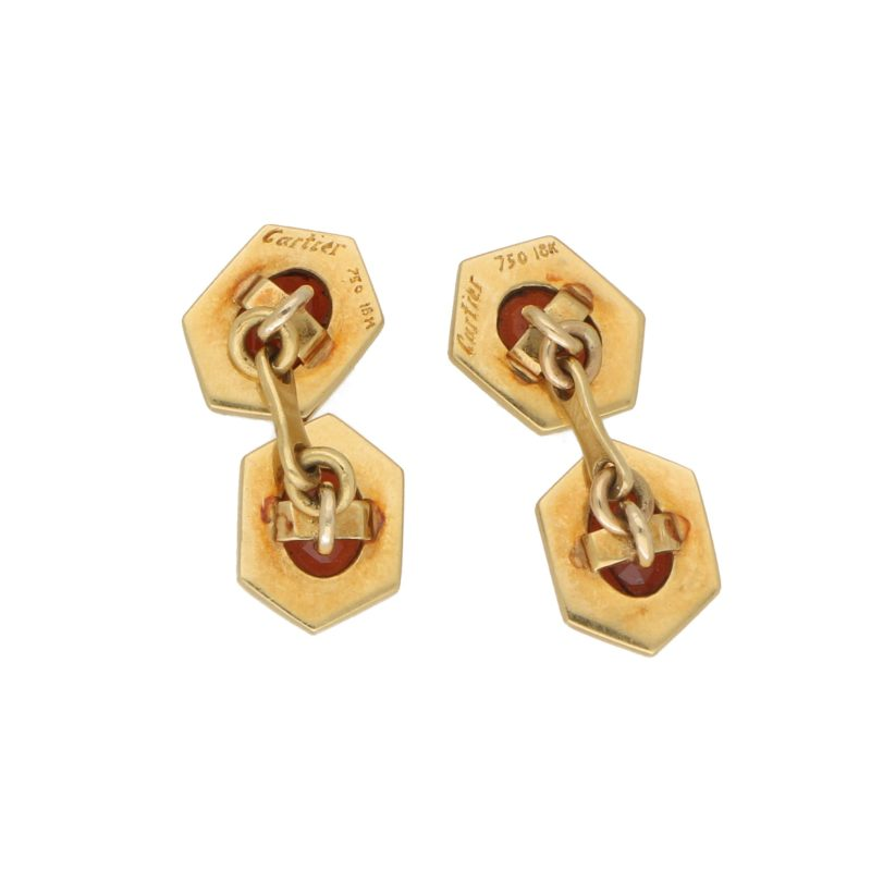 Cartier almandine garnet cufflinks in 18K yellow gold.