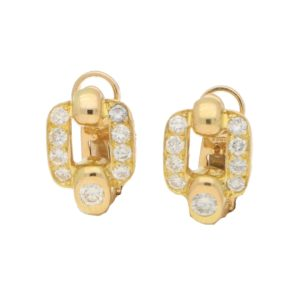 Cartier Retro style diamond earrings in 18k yellow gold.
