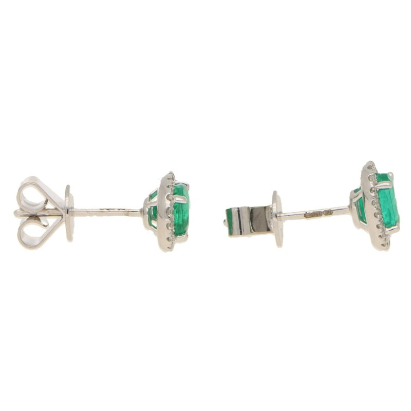 Emerald and diamond cluster earrings in 18K white gold.