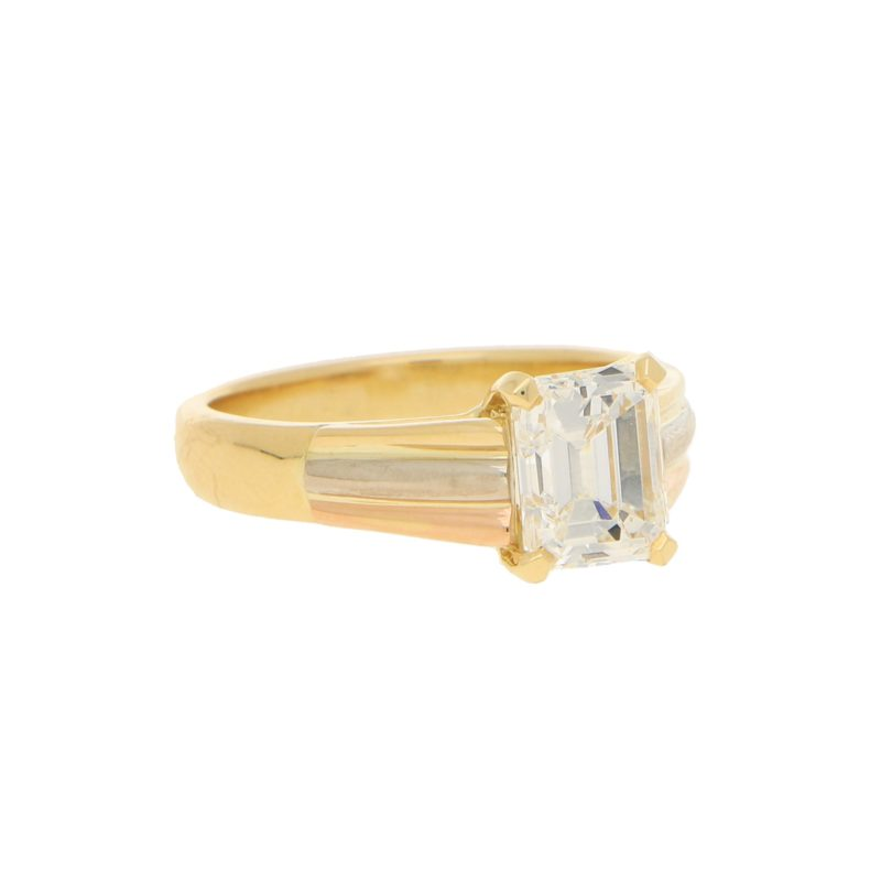 Emerald cut diamond solitaire ring in 18k tri colour gold.