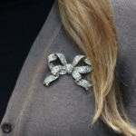 Victorian diamond bow brooch in silver and yellow gold.