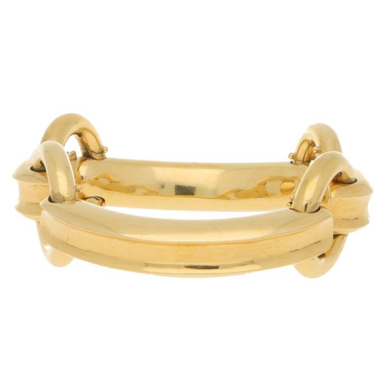 Bvlgari horse's bit bangle in 18k yellow gold.