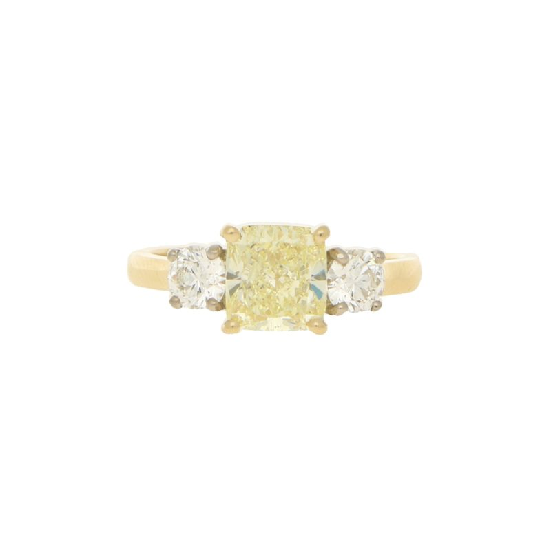 Fancy natural yellow and white diamond three stone ring