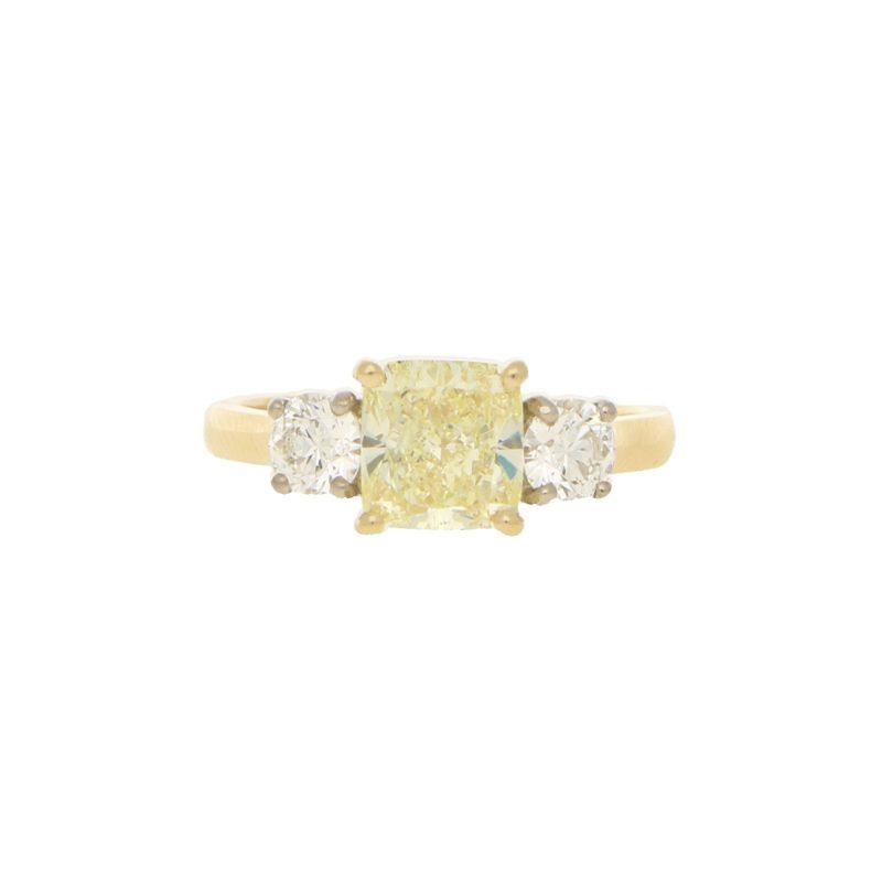 Fancy natural yellow and white diamond three stone ring