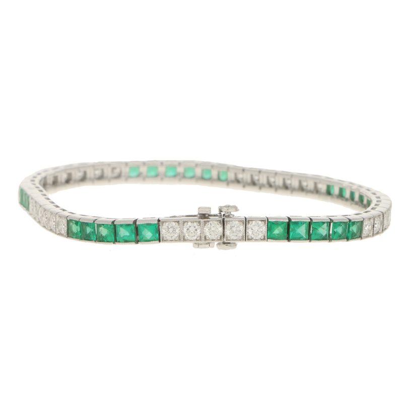 Platinum diamond and emerald line bracelet