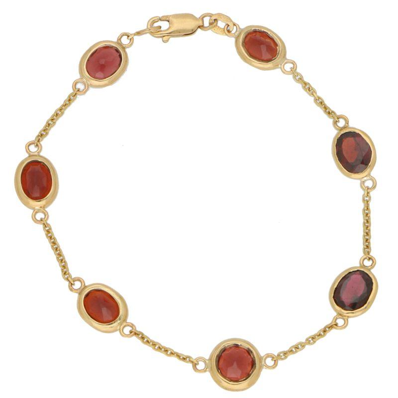 Red Garnet Spectacle Bracelet in 9k Yellow Gold