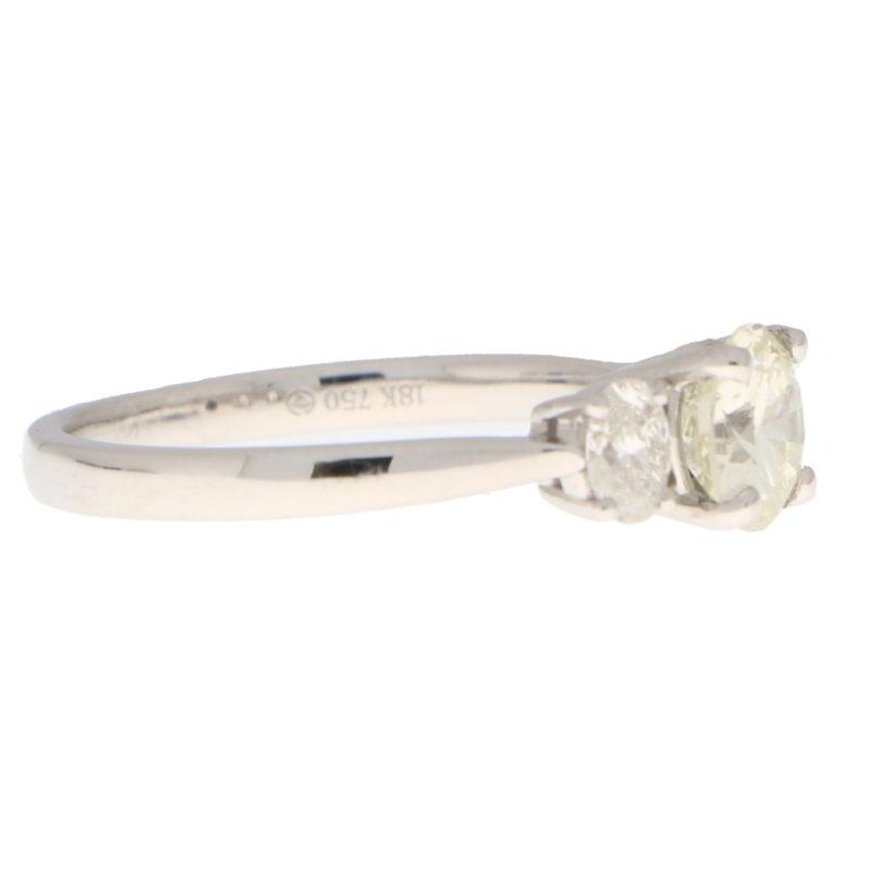 Pale Yellow Diamond Three Stone Ring