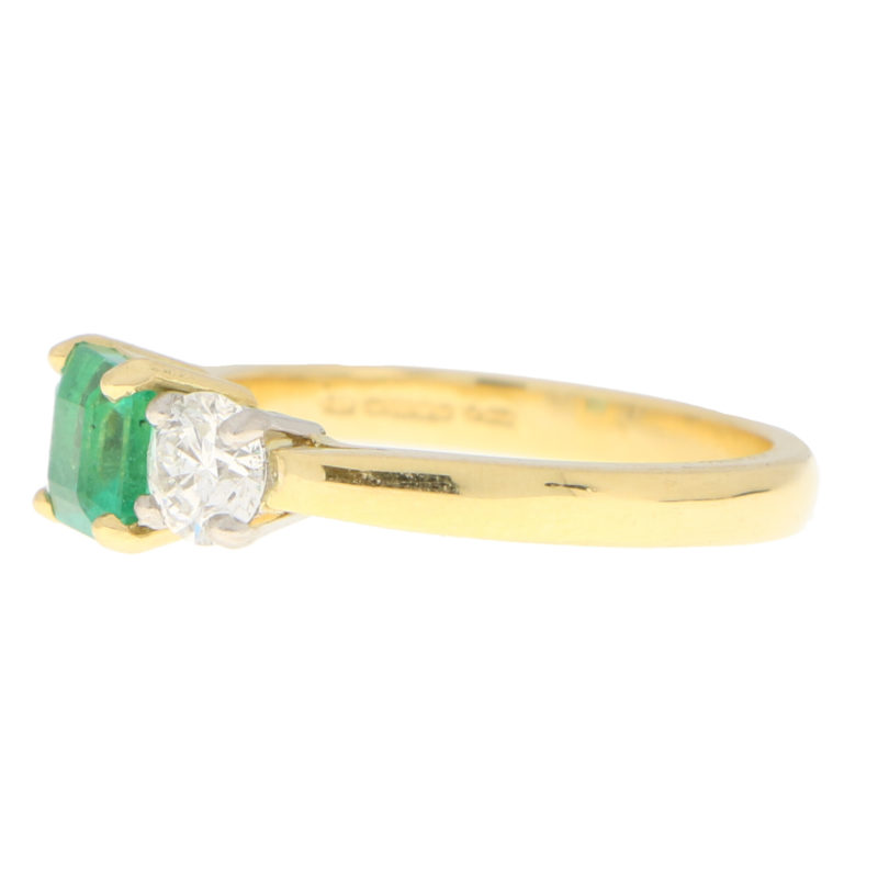 Emerald and Diamond Trilogy Engagement Ring in Yellow Gold