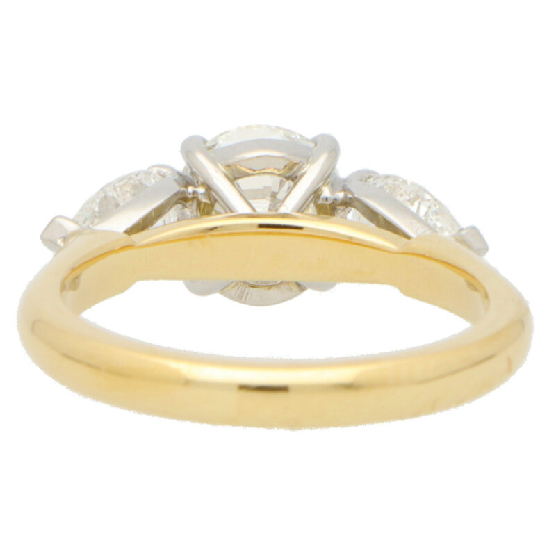 GIA Certified Round and Pear Cut Diamond Ring